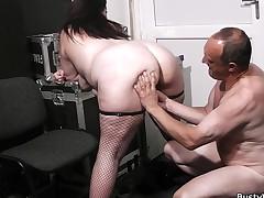 Fat ass plumper in fishnets rides boss knob
