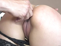 Naughty sexy Nicole Ferrera in darksome nylons shows her puffy pussy from behind as she gets her tight asshole dildoed. Stud plays with her juicy ass and then licks her slit