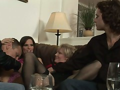 Syren De Mer and another hotwife swap husbands in bisexual foursome. Man unzips his jeans and gets his cock stroked by another man in front of two curious women. They like it