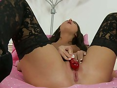 Dark haired babe Giselle Leon in sexy pattern stockings and high heels toy fuck her tight slit in the middle of the bed. This natural tits babe loves playing with her hot vagina