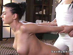 Hot busty lesbo getting massage with oil