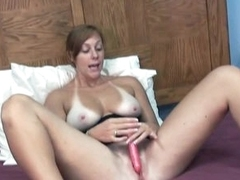 She bares her big tits and toys her hot slit
