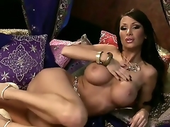 Spend great time looking at Sandee Westgate having unforgettable masturbation in this scene! Breasty sweetheart becomes nude before taking sex-toy and stuffing snatch by it.