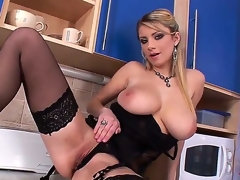 Sensual and arousing blonde honey in black lingerie and heels Katarina enjoys in stripping, teasing and playing with her big boobs as well as stretching her shaved taco in kitchen