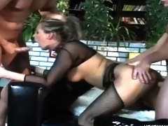 Wild blonde in fishnets Kimberly has two big dicks stretching her holes