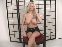 Nice-looking blonde cutie in panties Summer Haze teasing us with her massive big tits
