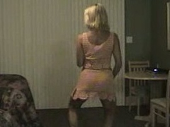 Older blonde milf dancing and gets her large billibongs out and flashes her snatch too.