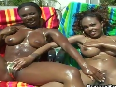 Tempting naughty Ariel with hot body and her black girlfriend with large juicy gazongas in bikinis enjoys touching each other by the pool and share meaty pecker in point of view