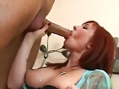 Red head MILF with big tits fucks her young neighbour
