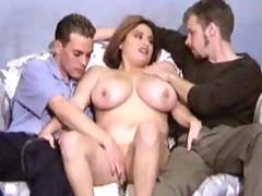 Helena blowing two stiff cocks