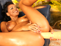 Sexy slut enjoys playing with her vibrator