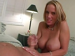 Busty blonde hottie gives their way man a hard handjob