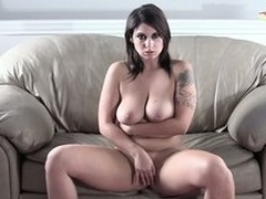 Lying on the couch, the hot chick masturbates plus reveals say no to remarkable tits plus ass