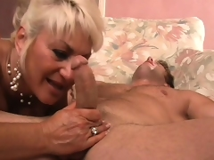 Stacked mature blonde is on the prowl for a young man with a large cock
