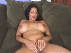 Saucy MILF with heavy breasts uses them to fuck a hung man