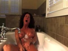 Hot milf masturbates in the tub