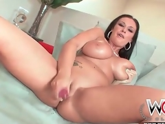 Curvy pornstar Bella Blaze disrobes and toys her cunt
