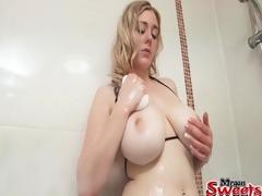 Bikini girl caresses her incredible big breasts