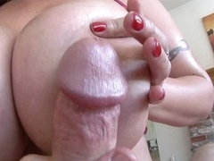 Big boobed older brunette juggfucking large cock with lube