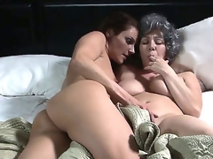 Teen gorgeous brunette lesbian RayVeness is lying in the bed with older girlfriend Samantha Ryan and seducing her for some wicked lesbian action.