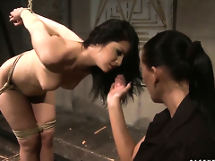 Brunette Mandy Bright with huge jugs finds herself getting her beaver rubbed by lesbo Naomie