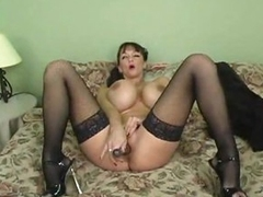 Huge meatballs babe in lipstick plays with vagina