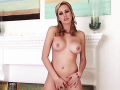 Brett Rossi with massive jugs and hairless twat shows it all in a tempting manner