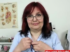 Redhead natural breasts milf stretches her bushy pussy