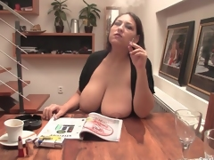 Chubby girl smokes with her large natural tits out