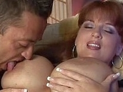 Redhead mild with huge natural tits in action