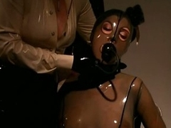Blonde Goddess Makes Breasty Resigned Brunette hair Wear Suffocating Latex Suit